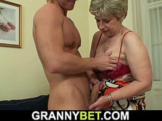 Old granny gulps his thick dick