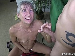 Granny wanks and sucks young hard-on