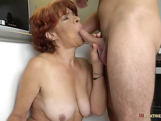 Redhead Granny Riding a Rock hard Wang