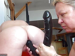 OldNanny Old round lady is masturbating youthful skinny lady with fat dildo