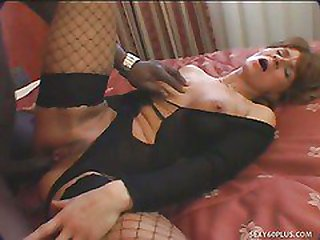 Mature Whore In Fishnets Takes Captured Rod