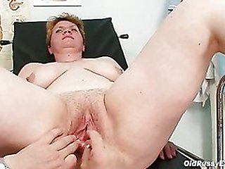 Gross mother gets a swab stick up her hairy pussy
