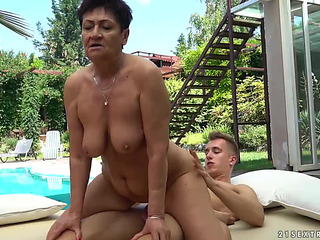 twenty one Sextreme:fearsome shorthaired granny goes for aged cumhole stuffing by the pool threateningmenacing PornDoe