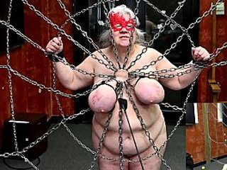 Granny enslaved has her tits tormented while bound to a web of chain (2020.02.29) (sklavin esclave soumise)