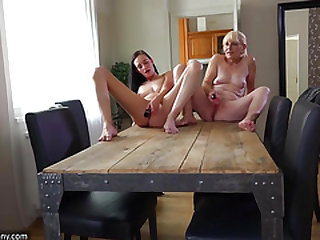 OldNanny Old chick and cute girl masturbating with faux-cock on the desk