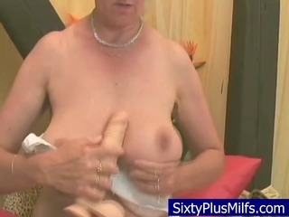 Granny fucking with her new toy hard-on